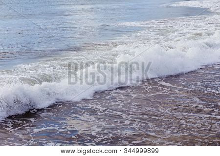 Waves Crashing On A Beach In Santa Cruz, California, Usa