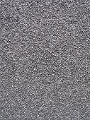 a dark grey very small pebble background poster