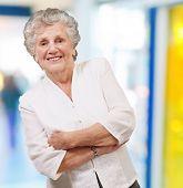 portrait of an adorable senior woman standing indoor poster