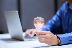 Business Hand Holding Light Bulb,with Brain Icon,creativity And Innovative Are Keys To Success,new I