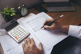 Budget Planning Concept,accountant Is Calculating Company's Annual Tax.calendar 2020 And Personal In