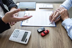 Car Rental And Insurance Concept, Young Salesman Presenting Promotion And Receive Money And Giving C