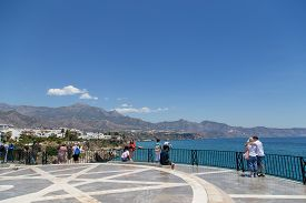 Nerja, Spain - May 28, 2019: People Enjoying The View From The Viewpoint Balcony Of Europe.