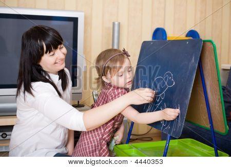 Prepare To School Series. Mother Teaching Her Daughter