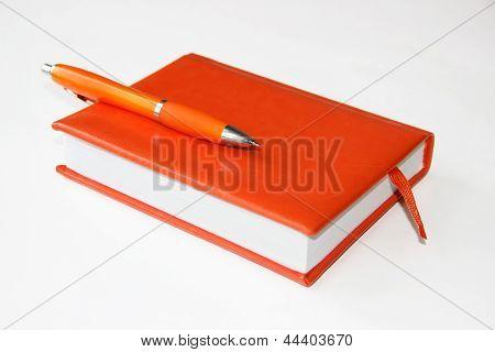 Orange Notebook And Pen