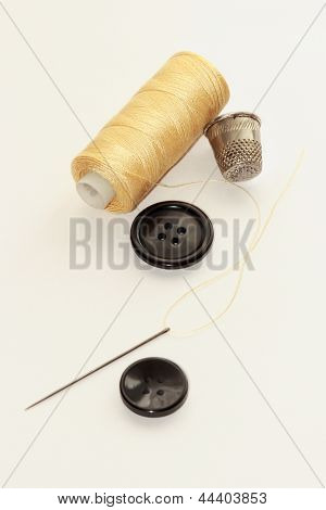 Spool Of Thread And Buttons And Needle