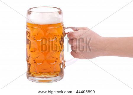 Woman's Hand Holding A Glass Of Beer