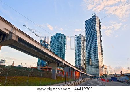 Miami Florida Brickell and downtown financial buildings and train bridge