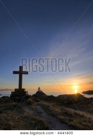 Sunset at Llanddwyn Island a sacred place with lighthouses and religious ruins poster