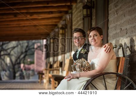 Smiling Newlyweds Sitting
