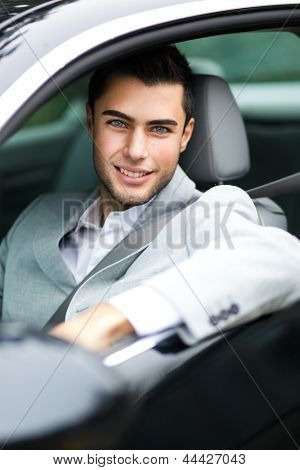 Handsome man in his new car