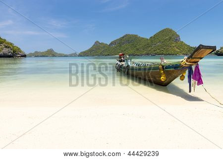 Traditional fishing longtail boat at Angthong national marine park near Koh Samui, Thailand poster