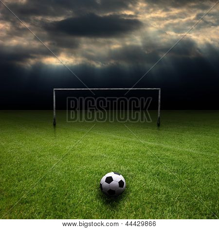 Football Pitch, With Dark Clouds