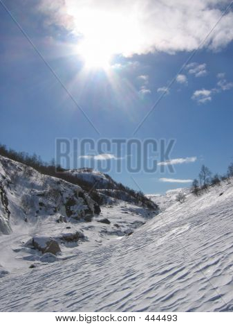 Sunshine Over Snowy Mountains