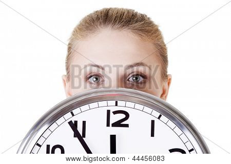 Portrait of shocked woman with clock over white background