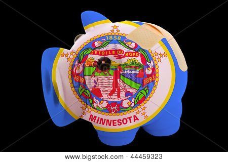Bankrupt Piggy Rich Bank In Colors Of Flag Of American State Of Minnesota    Closed With Bandage
