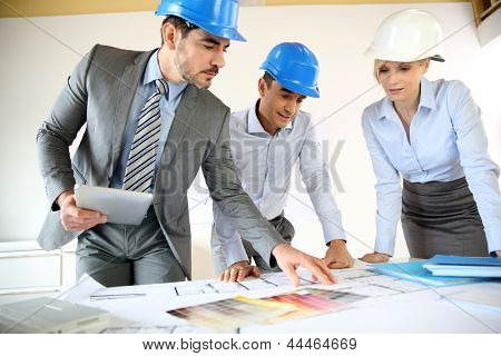 Team of architects presenting construction project