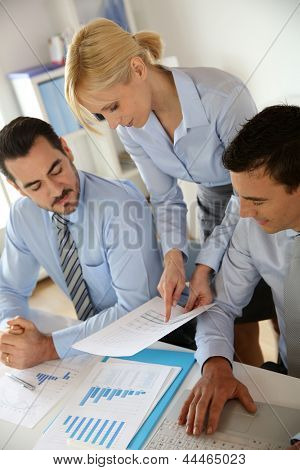 Corporate woman presenting results to sales team
