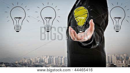 Business man holding light bulb in his hand