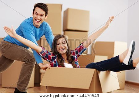 Couple having fun in new home