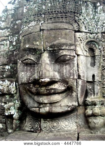 Stone Faces That Adorn The Towers Of Bayon