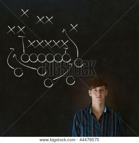 Man With American Football Strategy On Blackboard