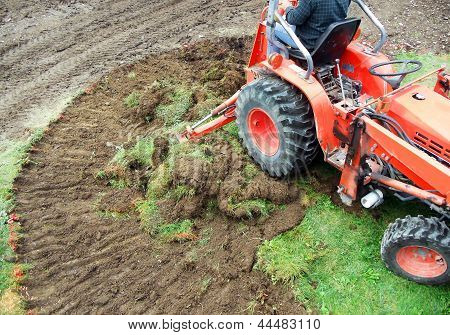 Tractor Emoving Turf