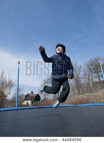 Fun On Trampoline At Springtime