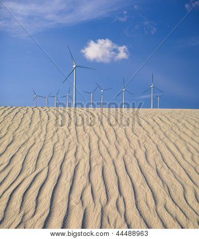 Wind Turbines Over Sand Dunes