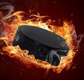 Hot hockey puck in fires flame poster