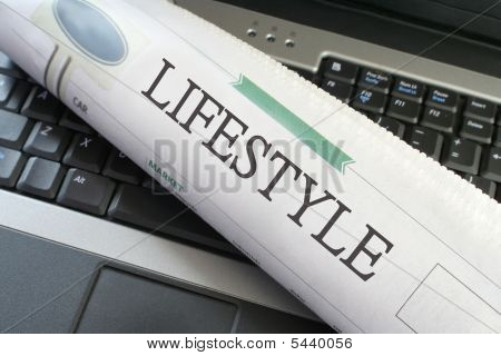 Lifestyle Section Of Newspaper On Laptop