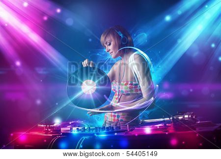Energetic Dj girl mixing music with powerful light effects poster