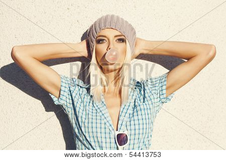 Trendy Beautiful Blonde Model And Blow Bubblegum