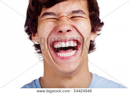 Close up portrait of loudly laughing young man isolated on white background