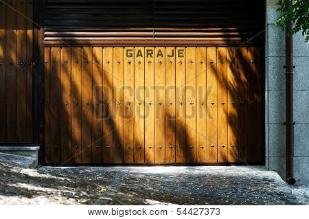 Garage Gates With Shadows Of Trees