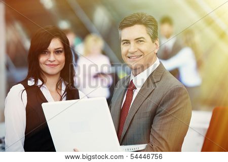 Two bussiness partnersman and woman over team background