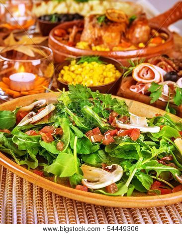 Fresh rocca salad with raw mushrooms, tasty vegetables, healthy lifestyle, various of tasty food on the table at home, dieting concept
