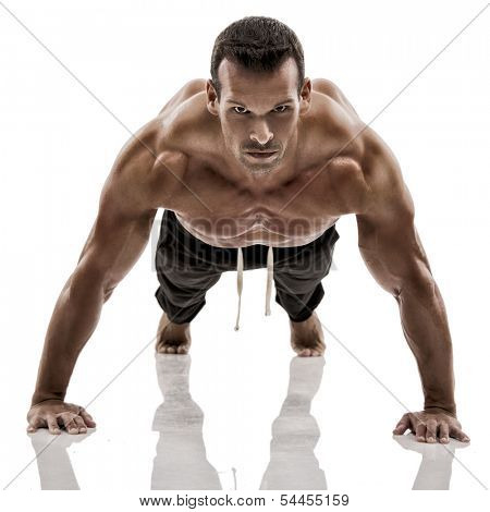 Muscle man dmaking push ups in studio, isolated over a white background