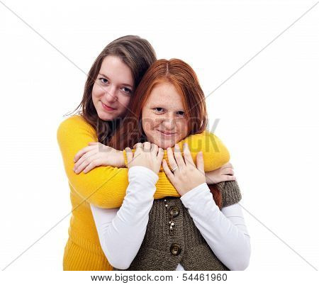 Two Teenager Girlfriends Embrace