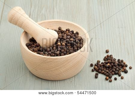 mortar and pestle with black pepper