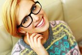 Closeup portrait of a young cheerful woman in glasses  poster