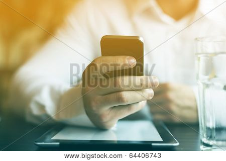 Man With Smartphone And Tablet Computer In Restaurant