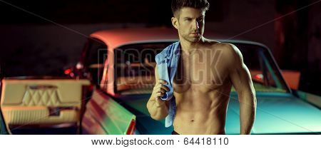 A young man on the background of car