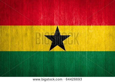 Ghana Flag On Wood Background