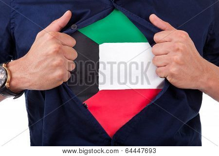 Young Sport Fan Opening His Shirt And Showing The Flag His Country Kuwait, Kuwaiti Flag