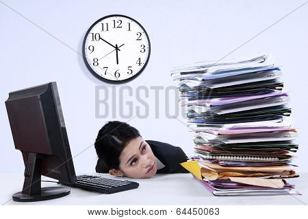 Businesswoman With Stack Of Document