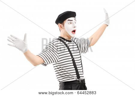 Surpised mime artist gesturing with hands, isolated on white background