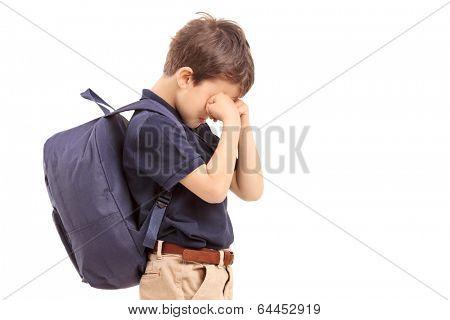 Schoolboy crying, isolated on white background