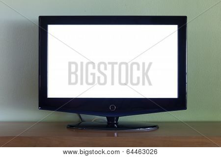 Black Flat Screen Tv Set On Wood Table