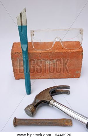 safety goggles,tools and brick.